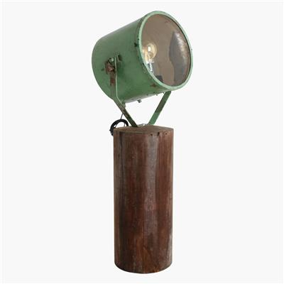 Green ship light on wooden base
